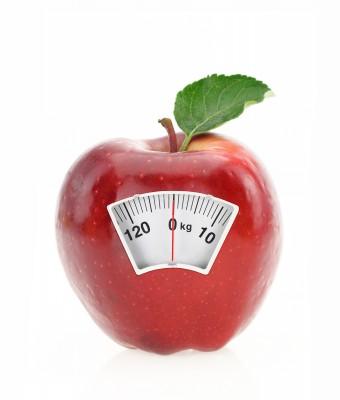 Composición de báscula de pesar en una manzana
